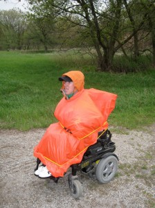 Jeff wrapped in a giant orange poncho