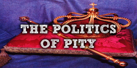 """The politics of pity"" written above a royal crown on a red pillow"